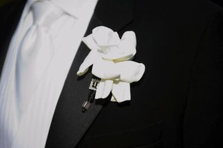 white-gardenia-flower-boutonniere-on-lapel-with-rhinestones