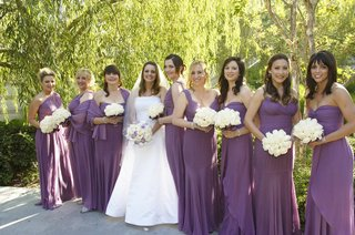 bride-with-bridesmaid-carrying-white-rose-bouquets