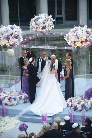 bride-and-groom-with-parents-under-clear-ceremony-structure