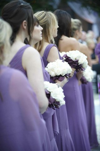 bridesmaid-bouquets-with-white-roses-and-purple-ribbon