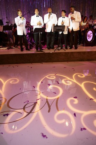 singers-in-white-tuxedo-jackets-at-wedding-reception