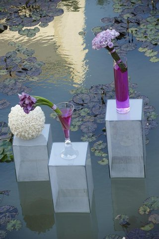 clear-lucite-risers-with-purple-calla-lily-flower-arrangements