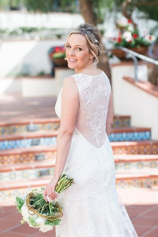 bride-in-a-sleeveless-claire-pettibone-dress-with-illusion-back-embroidery-white-bouquet