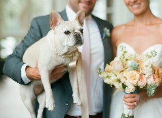 bride-and-groom-with-peach-wedding-bouquet-and-white-french-bulldog-with-satin-collar-and-leash
