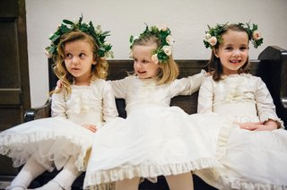 cute-flower-girls-sitting-on-bench-ivory-vintage-antique-flower-girl-dresses-and-flower-crowns