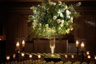 reception-escort-card-table-candle-light-white-rose-escort-cards-pillar-candles-and-votives