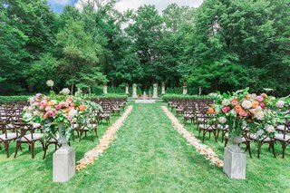 lucas-estate-wedding-trees-and-lawn-ceremony-pink-and-yellow-florals