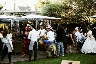 wedding-guests-in-costume-jessica-rabbit-jockey-horse-suspenders-costume-contest