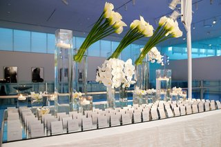 mirror-table-with-escort-cards-and-white-orchids-and-calla-lilies