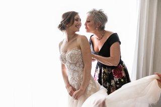 mother-of-bride-off-shoulder-black-gown-with-flower-print-skirt-bride-in-mira-zwillinger-dress
