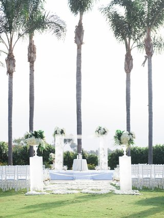 wedding-ceremony-of-stephanie-ming-and-levine-toilolo-palm-trees-white-decor-green-tropical-leaves