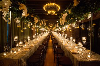 wedding-reception-in-new-york-with-long-rectangle-tables-glass-orbs-greenery-orchids-reception-hall