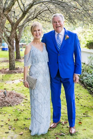 mother-of-bride-in-off-shoulder-light-blue-dress-flounce-top-father-of-bride-in-bright-blue-suit