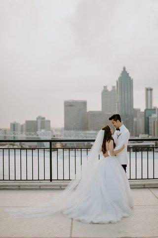 bride-in-tara-keely-ball-gown-wedding-dress-veil-groom-in-white-tuxedo-jacket-bow-tie-atlanta-ga