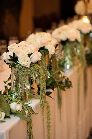 jars-filled-with-white-roses-and-amaranthus