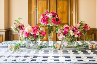 black-and-white-stripe-table-linen-with-heart-shaped-escort-place-cards-pink-roses-gold-candles