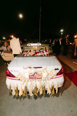 wedding-getaway-car-white-mercedes-sl550-with-just-married-letter-sign-and-gold-tassels-streamers
