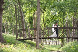 bride-and-groom-on-bridge-in-forest