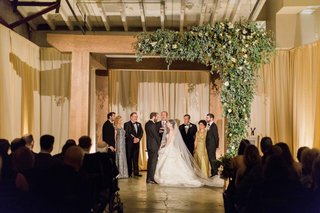 simple-wedding-ceremony-decor-with-wooden-arch-greenery-on-one-side