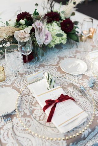 lace-linens-at-reception-menu-tied-with-red-velvet-ribbon