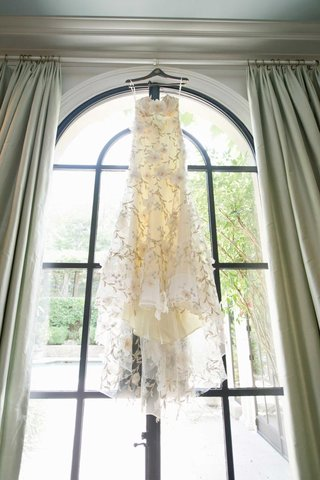 claire-pettibone-wedding-dress-hanging-in-window