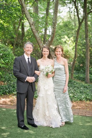 bride-with-father-and-mother-in-light-green-dress