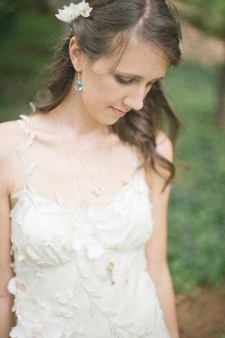 bride-wearing-light-blue-earrings-and-key-necklace