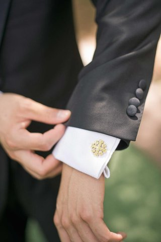 groom-wearing-vatican-gold-jerusalem-cross-cufflinks