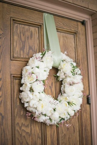 white-peony-wreath-with-green-ribbon-on-church-door