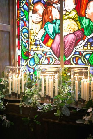 church-wedding-ceremony-with-candles-and-stained-glass