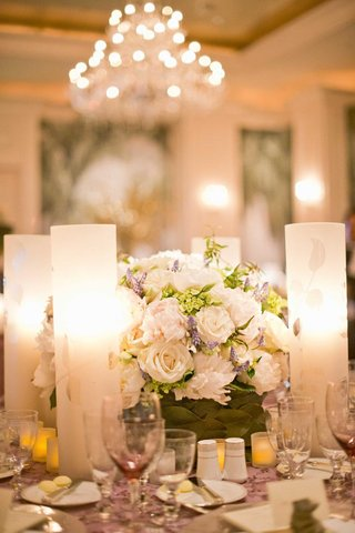 white-roses-and-lavender-next-to-frosted-candleholder
