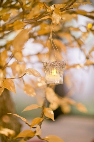 gold-lea-centerpiece-with-hanging-votive-and-tea-light