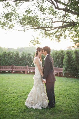 bride-with-asian-american-groom-in-grass-park