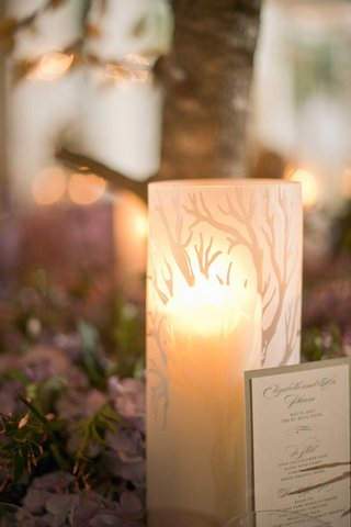 tree-motif-on-glass-candle-vessel-on-reception-table