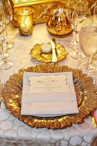 gold-charger-plates-white-detailed-table-linens-vintage-inspired-menu-reception-decor