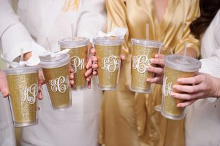 glittery-gold-drink-tumblers-with-straws-bows-with-monograms-for-bridesmaid-gift