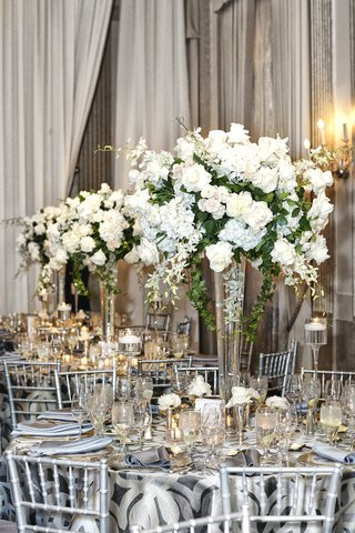 silver-table-linens-and-chairs-with-large-centerpiece