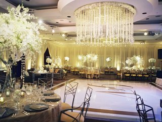ceiling-flower-and-crystal-arrangement-over-dance-floor-in-ballroom-reception-monogram-dance-floor