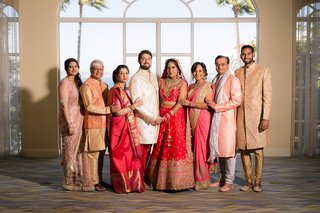 bride-and-groom-with-family-members-in-traditional-attire-san-diego-coronado-island-multi-day-event