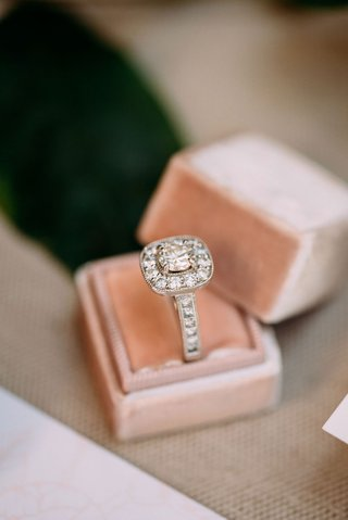wedding-ring-engagement-ring-displayed-in-velvet-blush-mrs-box-diamonds-on-band-and-halo