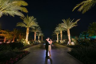 bride-in-short-second-wedding-dress-with-groom-in-suit-looking-into-each-others-eyes-at-resort