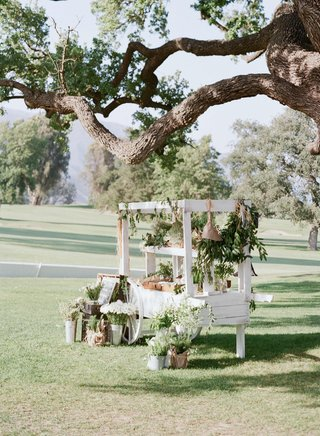 white-flower-cart-with-shabby-chic-decorations-and-herbs