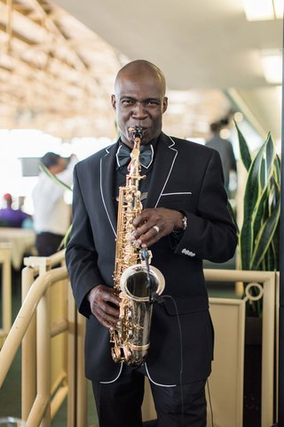 wedding-entertainment-saxophone-sax-player-at-race-track-santa-anita-black-suit-with-white-piping