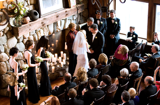 overhead-shot-of-wedding-ceremony-next-to-stone-fireplace