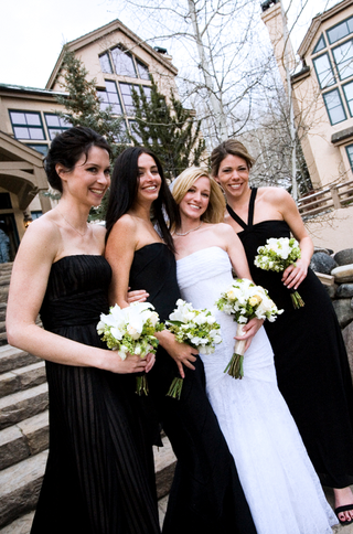 bride-with-three-bridesmaids-in-long-black-gowns