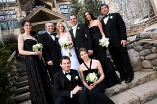 newlyweds-with-groomsmen-and-brides-wearing-black-dresses