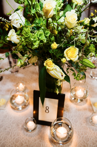 tabletop-with-yellow-and-green-centerpiece-and-floating-candles