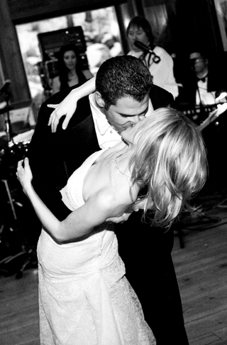 groom-dips-bride-and-kisses-her-on-the-dance-floor