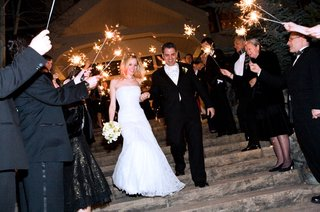 newlyweds-pass-through-guests-holding-sparklers