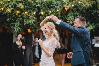 sunset-wedding-reception-father-of-bride-spins-daughter-on-dance-floor